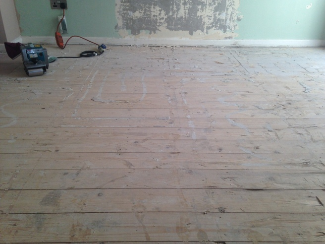 Floorboards before sanding